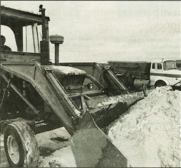 Photo of a Front End Loader scooping up a load of lime