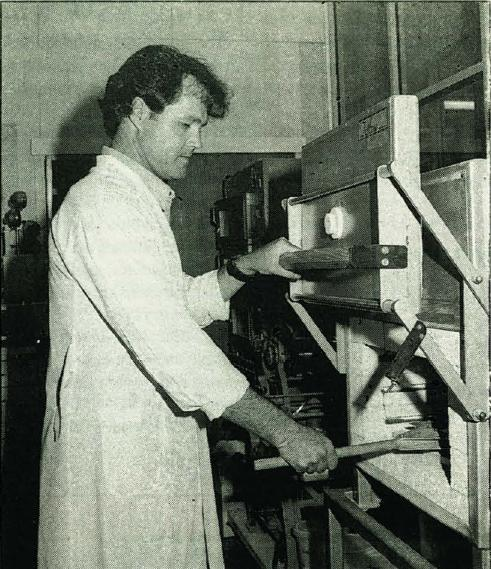 Andrew Ross removes Arabic Oat bread from a test oven at the Bread Research Institute. Mr Ross. is studying the effect of interactions between starch and protein on bread quality. Institutions: University of New South Wales and  the Bread Research Institute 01' Australia.