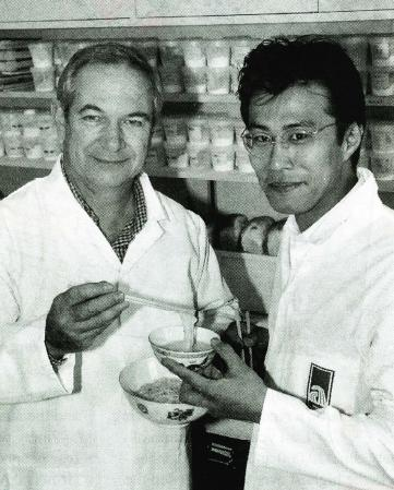 Tomoo Moro, right, of Nippon Flour Mills, seen here with Graham Crosbie, tastes noodles made from new wheat varieties.