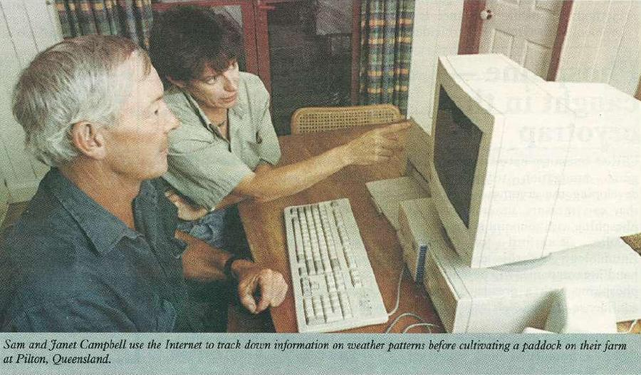 Sam and Janet Campbell use the Internet to track down information on weather patterns before cultivating a paddock on their farm at Pilton, Queensland.