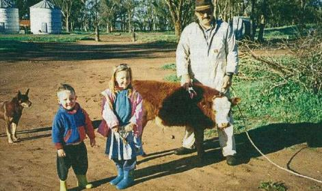 Grower Alan Johnston of 'Longlands', Naradhan, central NSW, with children Royce (left) and Cherice and their calf, 'Bobby