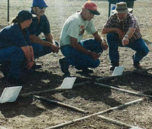 At a recent field day at Minlaton in SA, SABDI entomologist Dennis Hopkins points out to growers the relative densities of snails in trial plots.
