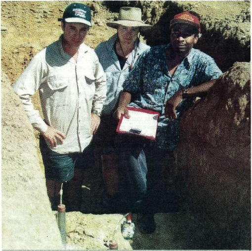 Down and dirty for science: (left to right) Ben Gready, Cas'sie Schefe and Isa Yunusa, all of Agriculture Victoria, Rutherglen, measure water infiltration in a soil pit. Acacia roots form large pores that conduct water