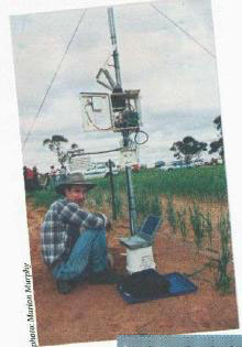 David Roget downloads data from the weatlier station at Werrimull research site. Research is showing opportunity for big production increases across mallee country