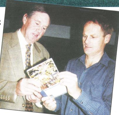 Mr Ian MacKinnon(left) showing a pocket-sized pictorial guide to Michael Wurst