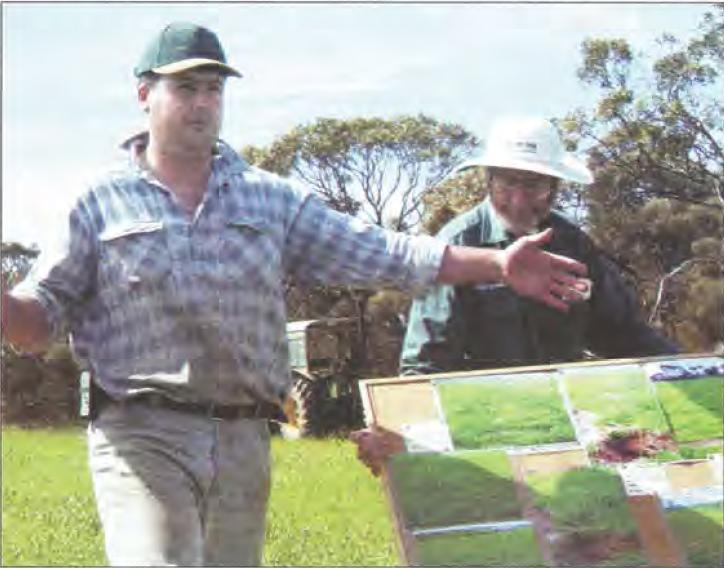 Grower Shaun Slater (left) and consultant Cliff Hignett describe the trial results at a field day.