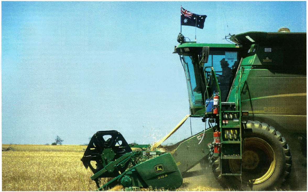 """AIMING TO LEAD THE WORLD: grower Theo Marshall, from Hyden, Western Australia, was inspired to fly the Australian flag on his header by Lleyton Hewitt's success. Theo likes the idea of carrying the same enthusiasm and winning spirit into his farming. And as AWB's general manager of grain technology, Andrew McConville, says: """"At the end of the day our competition is not here on our shores, the competition is overseas and we've all got to compete against it. """""""