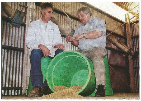 NSW Agriculture's technical officer, Rob Inglis (left), and animal nutrition expert, Alan Kaiser, discuss the results from research into digestibility of oats at Wagga Wagga Agricultural Institute,