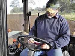 Photo of contractor using a logbook