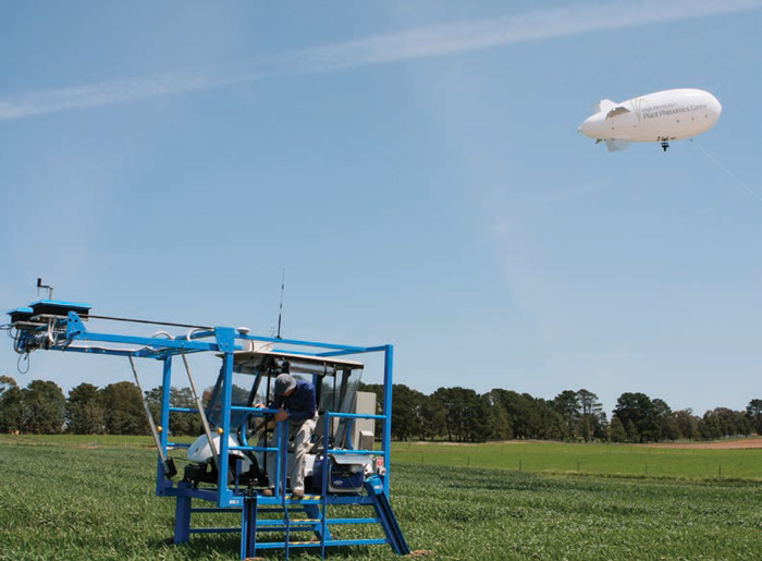 Crop Mobile Module in action; a man stands in the buggy in the foreground while the blimp is airborne in the background.