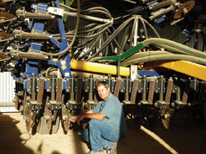A photo of David Hermann with machinery