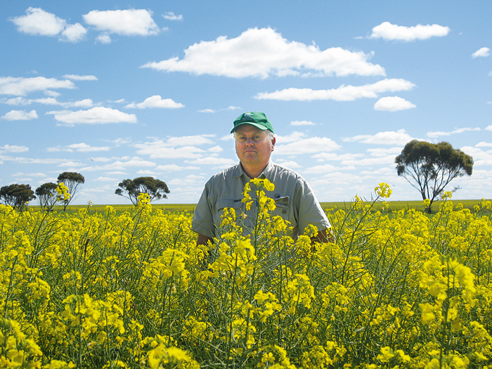 Photo of a man in a field of yellow flowers