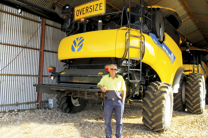 Photo of a man in front of an 'oversize' machine