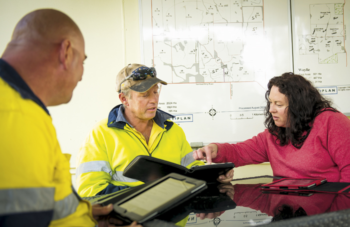 Photo of farmhand Linsday Johns and Lance and Erin Turner