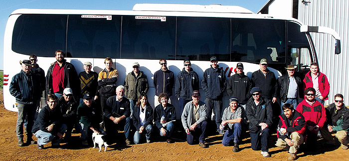 Image of a group of people next to a tour bus
