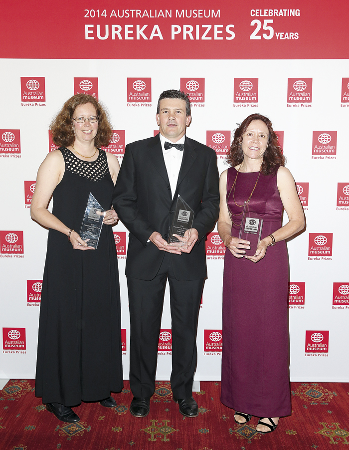 Photo of man and 2 women with awards at the Australian Museum Eureka Prize night 2014