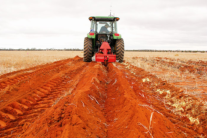 Image of a tractor and soil