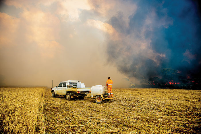 Volunteers battling to protect a crop at Scaddan, north of Esperance, WA, in November