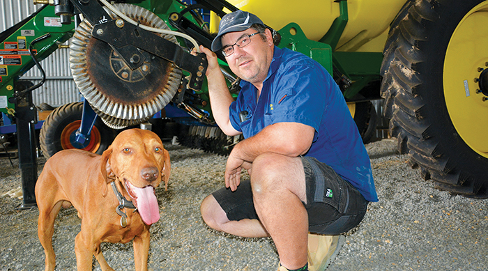 Image of grower Robert Ruwoldt with his dog, Ollie