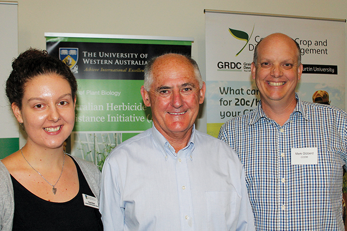 Portrait of Brogan Micallef, Prof Steve Powles and Prof Mark Gibberd at a conference