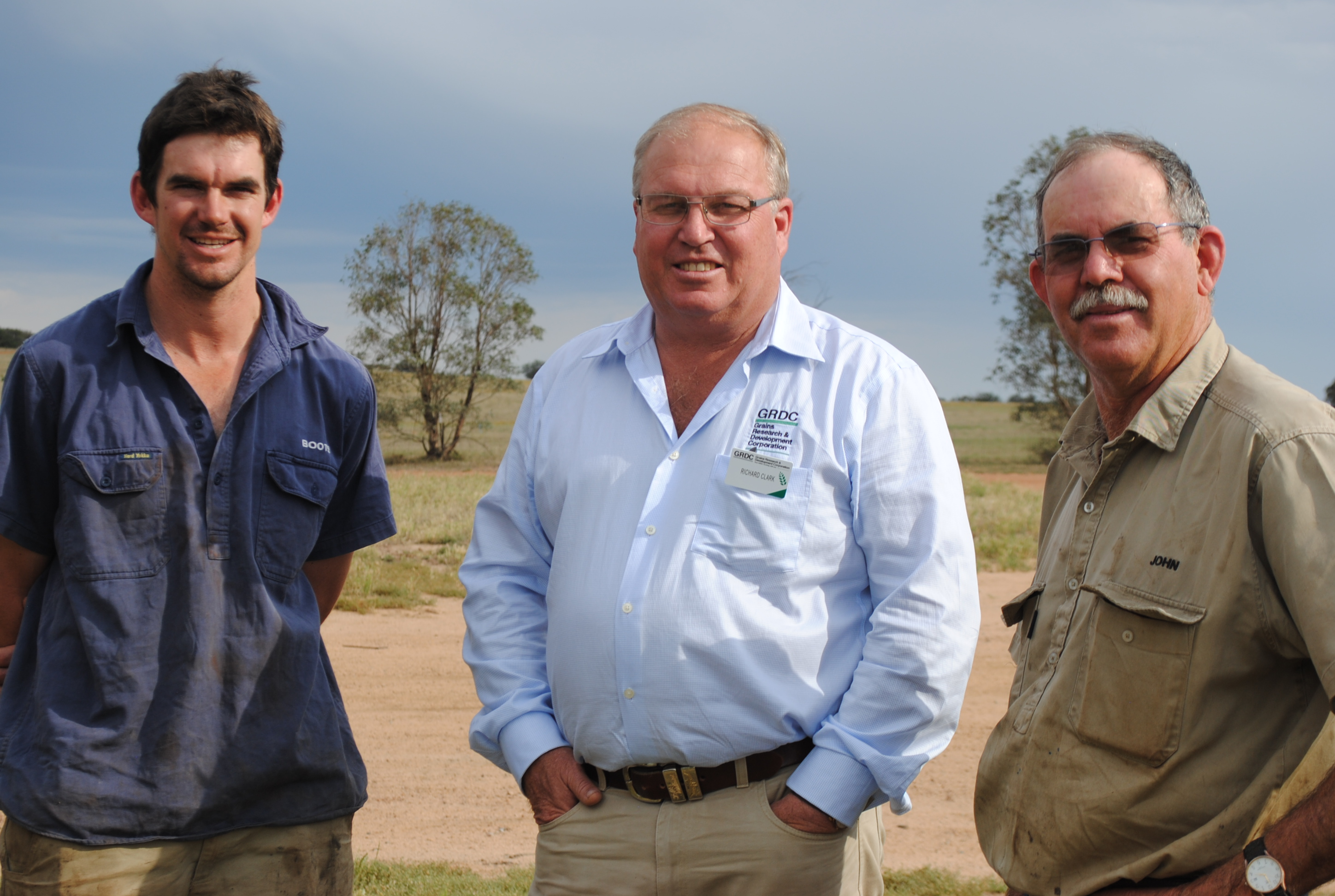 Growers Daniel and John Wellington in a field with GRDC chairman Richard Clark