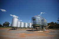 Line of silos on brown dirt