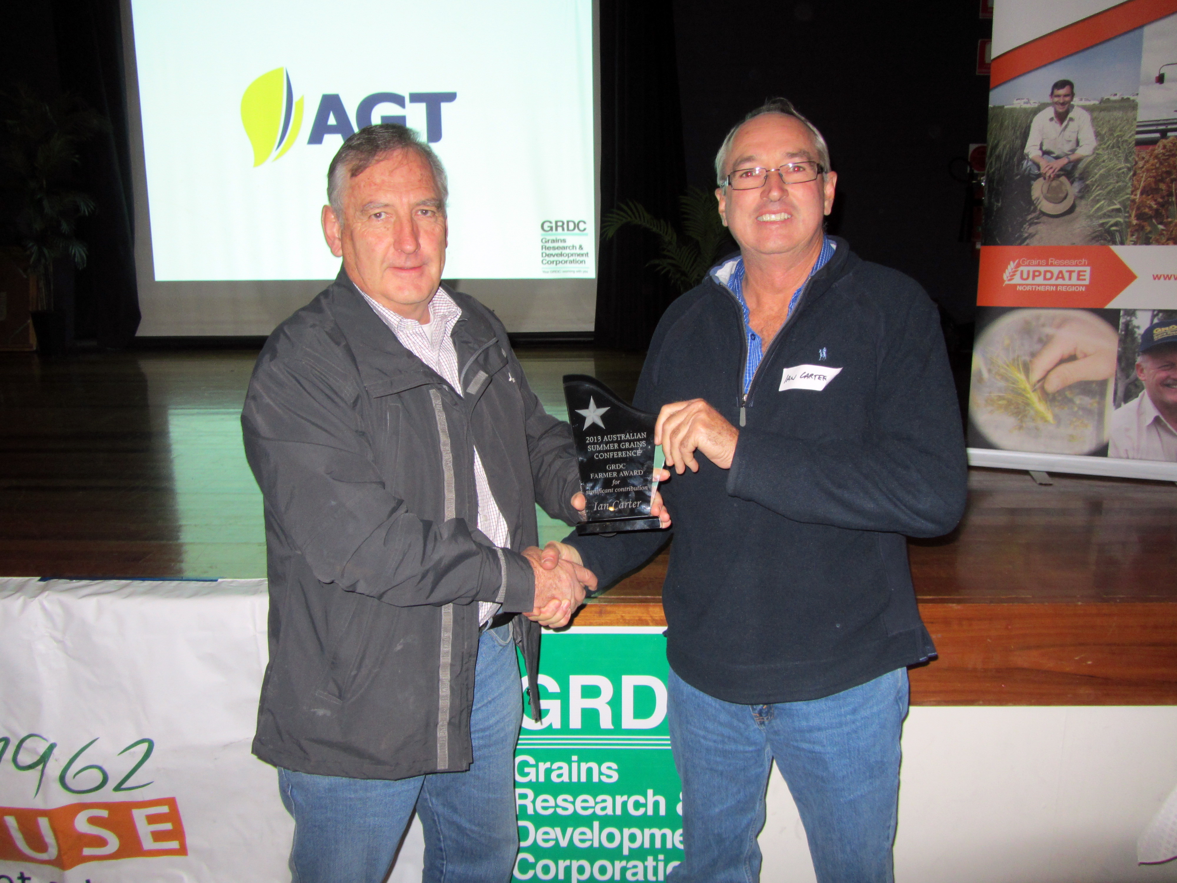 Keith Harris, GRDC northern panellist presents Liverpool Plains grower Ian Carter with the 2013 Summer Grains Conference GRDC Farmer of the Year award