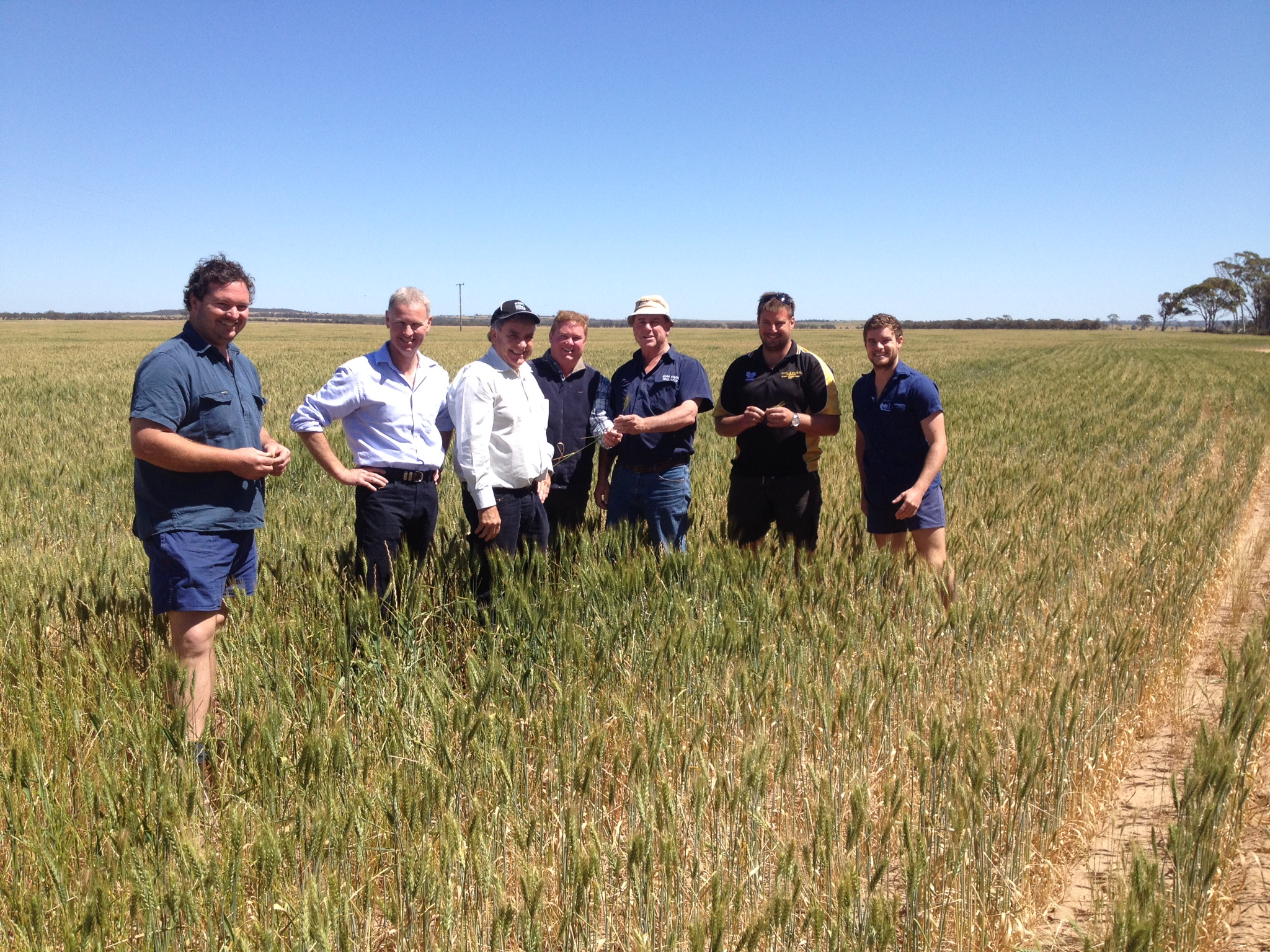 John Harvey and Peter Roberts in a paddock with growers in WA.